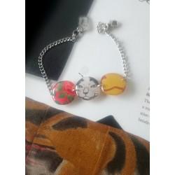 Bracelet chat  et camélia...