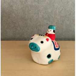Ox mounted by a small character mini figurine